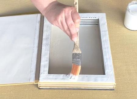 Painting glue on the top of the pages
